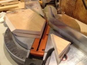 Use a chop saw to cut the front and back panels at a 45 degree angle.