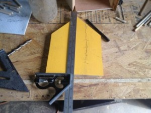 Use a carpenter's square to mark the center line on the front panel for the opening and the perch.