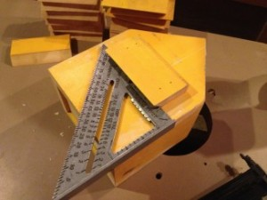 Use a carpenter's triangle as a quick short-cut guide to ensure you fasten the cleat straight on the back of the birdhouse.